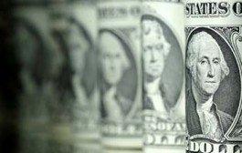 Dólar opera em queda, de olho no exterior e em passos do novo governo