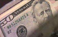 Dólar opera quase estável nesta sexta-feira